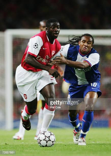 Kolo Toure of Arsenal holds off Anderson of FC Porto during the UEFA Champions League Group G match between Arsenal and FC Porto at The Emirates...