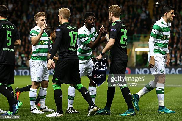 Kolo Toure of Celtic and Andre Hahn of Borussia Monchengladbach holding a 'No to Racism' pennant shake hands before kick off during the UEFA...
