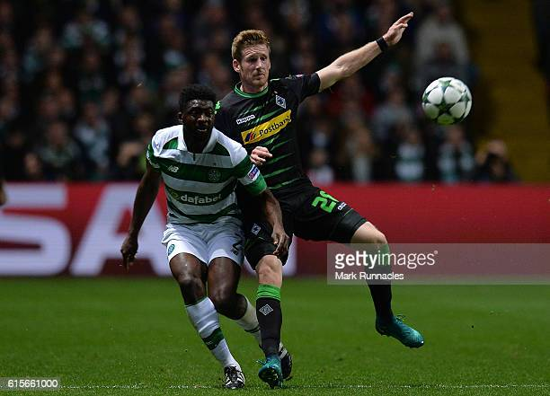 Kolo Toure of Celtic FC is tackled by Andre Hahn of VfL Borussia Moenchengladbach during the UEFA Champions League match between Celtic FC and VfL...