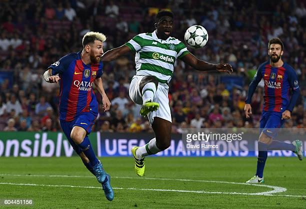Kolo Toure of Celtic is put under pressure from Lionel Messi of Barcelona during the UEFA Champions League Group C match between FC Barcelona and...