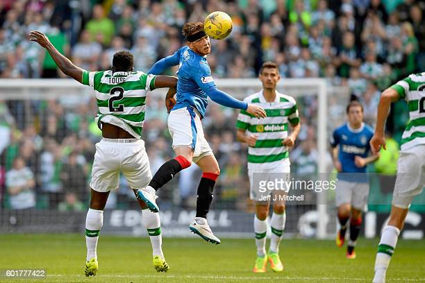 Kolo Toure of Celtic tackles Joe Garner of Rangers during the Ladbrokes Scottish Premier league match between Celtic and Rangers at Celtic Park at...
