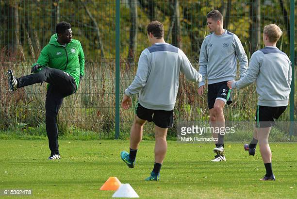 Kolo Toure of Celtic warms up with team mates during a Celtic training session on the eve of their UEFA Champions League Group C match against...