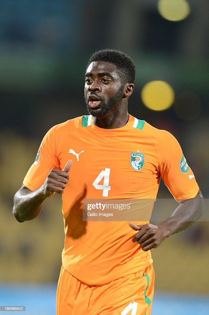Kolo Toure of Ivory Coast and Foued Kadir of Algeria during the 2013 African Cup of Nations match between Algeria and Ivory Coast at Royal Bafokeng Stadium on January 30, 2013 in Rustenburg, South Africa.