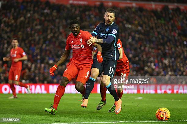 Kolo Toure of Liverpool and Aleksandar Kolarov of Manchester City battle for ball during the Barclays Premier League match between Liverpool and...