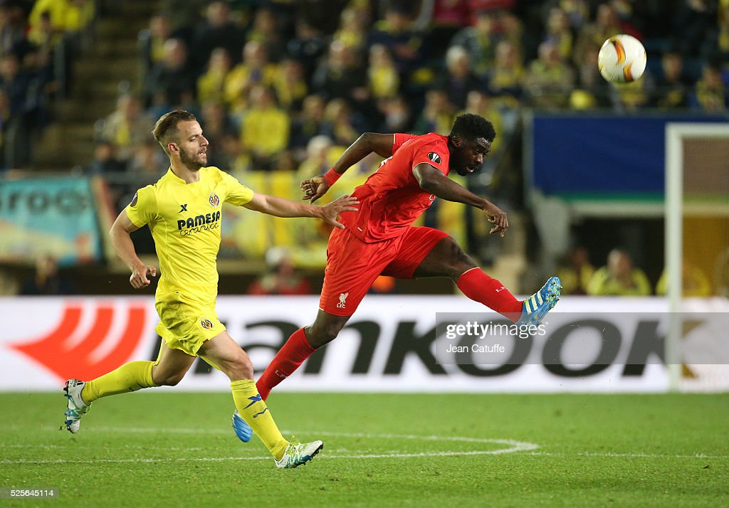 Kolo Toure of Liverpool and Roberto Soldado of Villarreal (left) in action during the UEFA Europa League semi final first leg match between Villarreal CF and Liverpool FC at Estadio El Madrigal stadium on April 28, 2016 in Villarreal, Spain.