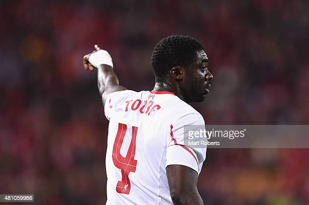 Kolo Toure of Liverpool FC signals to his team mates during the international friendly match between Brisbane Roar and Liverpool FC at Suncorp...