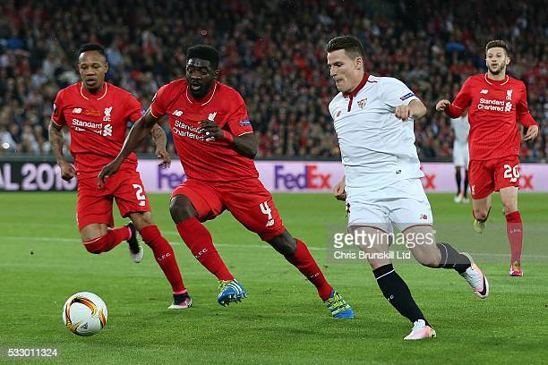Kolo Toure of Liverpool in action with Kevin Gameiro of Sevilla during the UEFA Europa League Final match between Liverpool and Sevilla at St...