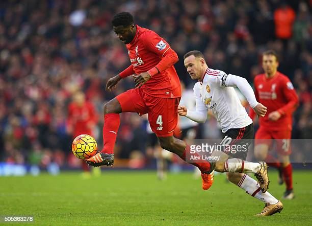 Kolo Toure of Liverpool is closed down by Wayne Rooney of Manchester United during the Barclays Premier League match between Liverpool and Manchester...