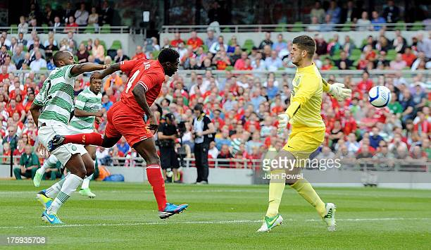 Kolo Toure of Liverpool scores an offside goal during a Pre Season friendly against Celtic and Liverpool at Aviva Stadium on August 10 2013 in Dublin...