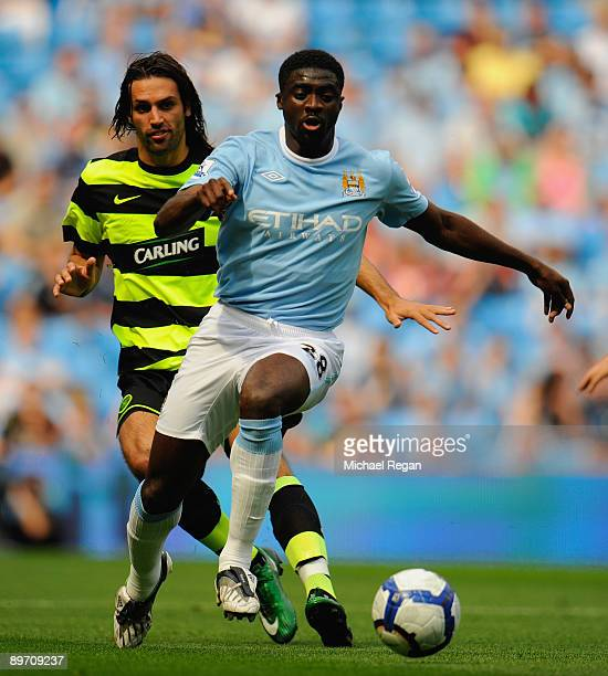 Kolo Toure of Manchester City and Georgios Samaras of Celtic during the pre season friendly match between Manchester City and Celtic at the City of...