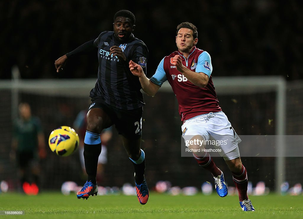 Kolo Toure of Manchester City is challenged by Matt Jarvis of West Ham United during the Barclays Premier League match between West Ham United and Manchester City at the Boleyn Ground on November 3, 2012 in London, England.