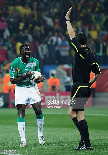 Kolo Toure of the Ivory Coast shouts at referee Alberto Undiano after he makes a decision during the 2010 FIFA World Cup South Africa Group G match...