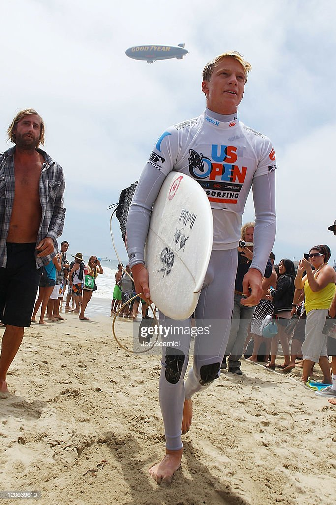 Kolohe Andino of USA comes in after losing his semifinal heat against Yadin Nicol of Australia at the Nike US Open of Surfing on August 7 2011 in...