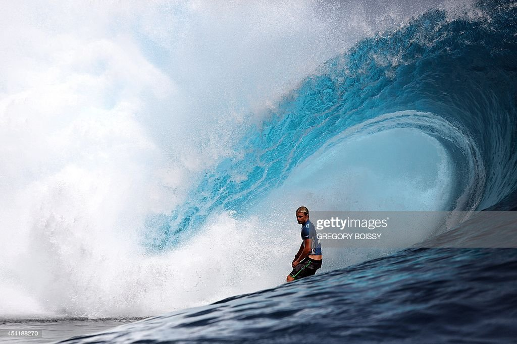 US Kolohe Andino rides a wave during the finale of the 14th edition of the Billabong Pro Tahiti surf event, part of the ASP (Association of Surfing Professionals) world tour, on August 25, 2014 in Teahupoo, on the French Polynesian island of Tahiti. Brazil's Gabriel Medina won over US Kelly Slater.
