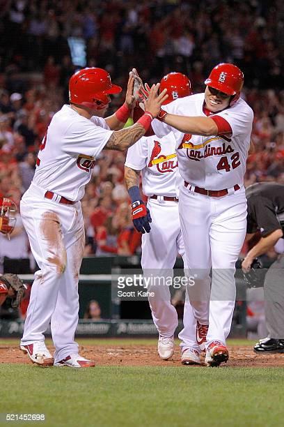 Kolten Wong congratulates Aledmys Diaz of the St Louis Cardinals after Diaz hit a threerun home run during the third inning of a baseball game at...