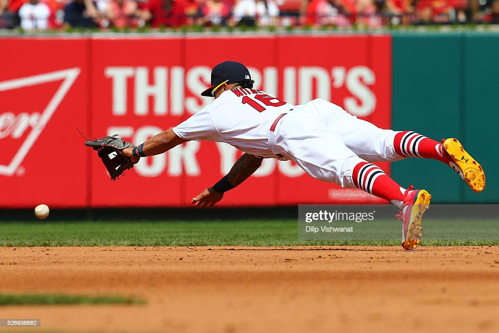Kolten Wong #16 of the St. Louis Cardinals attempts to field a line drive against the Washington Nationals in the sixth inning at Busch Stadium on May 1, 2016 in St. Louis, Missouri.