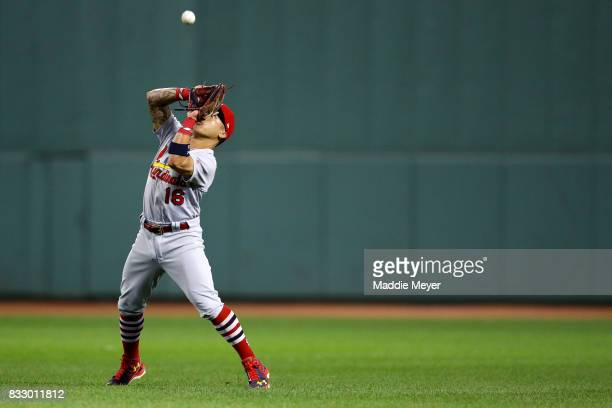 Kolten Wong of the St Louis Cardinals catches a fly ball hit by Mookie Betts of the Boston Red Sox during the seventh inning at Fenway Park on August...