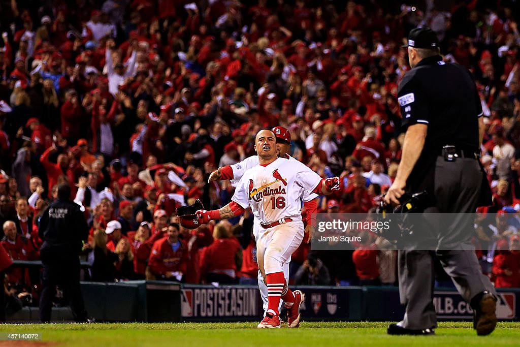 Kolten Wong #16 of the St. Louis Cardinals celebrates his solo home run in the ninth inning to give the St. Louis Cardinals the 5 to 4 win over the San Francisco Giants during Game Two of the National League Championship Series at Busch Stadium on October 12, 2014 in St Louis, Missouri.