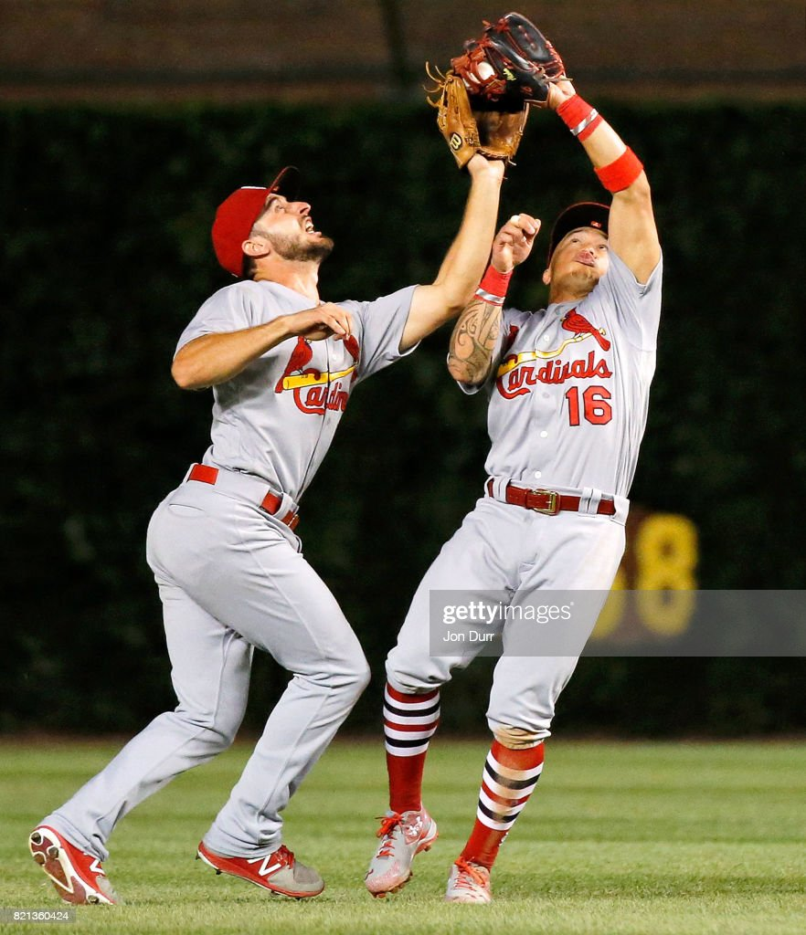 Kolten Wong #16 of the St. Louis Cardinals collides with Paul DeJong #11 but makes the catch for an out on a fly ball off the bat of Ben Zobrist of the Chicago Cubs (not pictured) to end the seventh inning at Wrigley Field on July 23, 2017 in Chicago, Illinois.