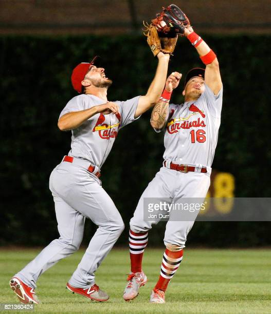 Kolten Wong of the St Louis Cardinals collides with Paul DeJong but makes the catch for an out on a fly ball off the bat of Ben Zobrist of the...