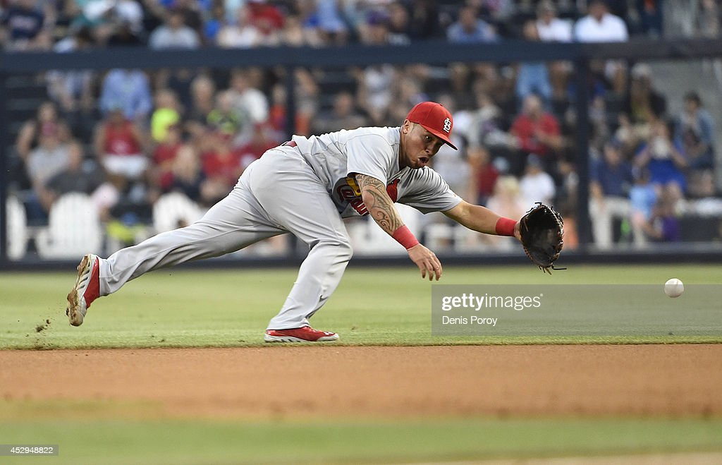 Kolten Wong #16 of the St. Louis Cardinals dives but can't make the catch on an RBI single hit by Yangervis Solarte #27 of the San Diego Padres during the first inning of a baseball game at Petco Park July 30, 2014 in San Diego, California.