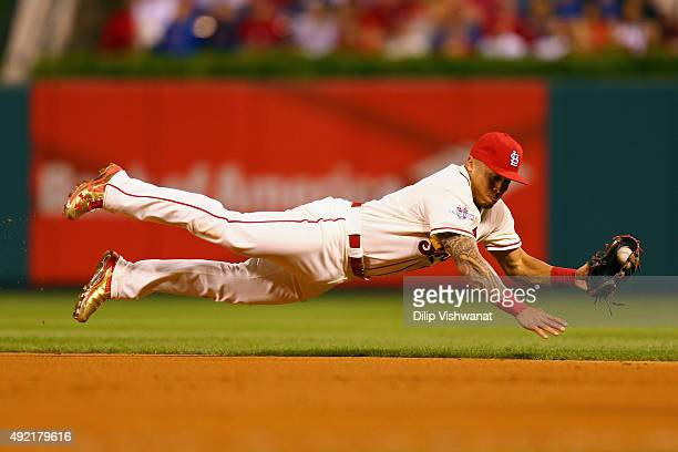 Kolten Wong of the St Louis Cardinals dives to field a ground ball in the ninth inning against the Chicago Cubs during game two of the National...