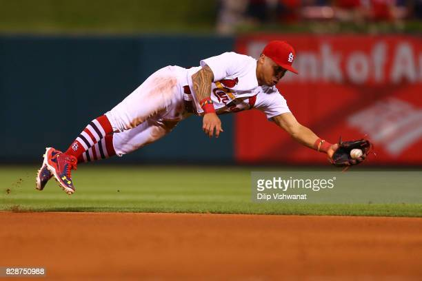 Kolten Wong of the St Louis Cardinals fields a ground ball for the final out against the Kansas City Royals in the ninth inning at Busch Stadium on...