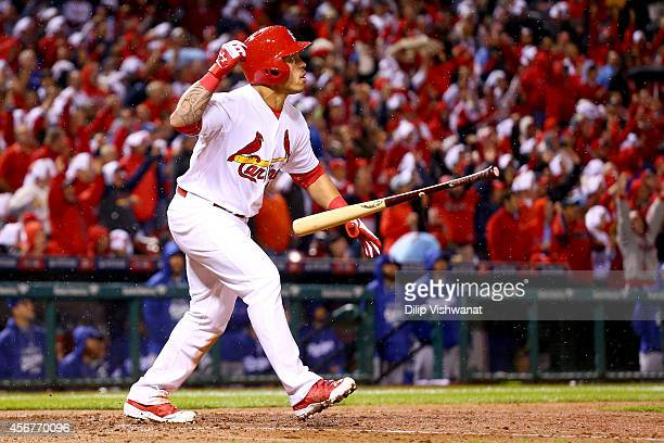 Kolten Wong of the St Louis Cardinals hits a tworun home run in the seventh inning against the Los Angeles Dodgers in Game Three of the National...