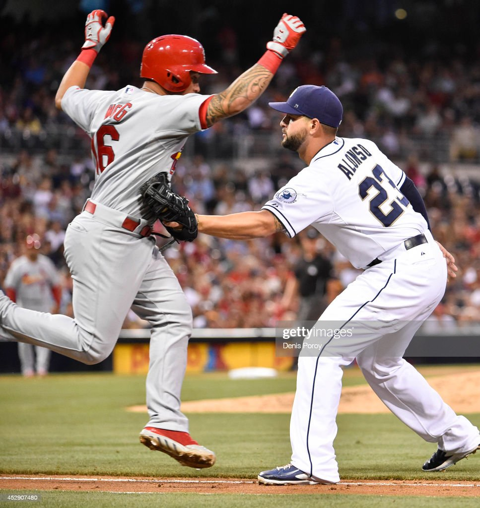 Kolten Wong of the St Louis Cardinals is tagged out by Yonder Alonso of the San Diego Padres during the third inning of a baseball game at Petco Park...