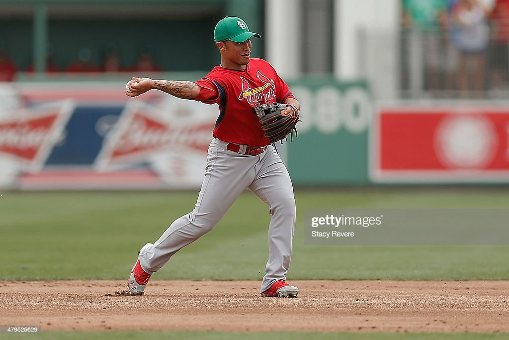 Kolten Wong #16 of the St. Louis Cardinals makes a throw to first base in the second inning of a game against the Boston Red Sox at JetBlue Park at Fenway South on March 17, 2014 in Fort Myers, Florida. Boston won the game 10-5.