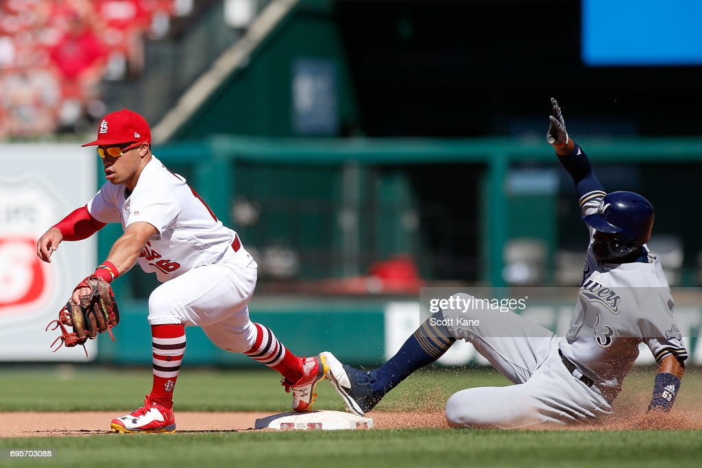 Kolten Wong #16 of the St. Louis Cardinals makes the final out of the game against Keon Broxton #23 of the Milwaukee Brewers during the ninth inning at Busch Stadium on June 13, 2017 in St. Louis, Missouri.