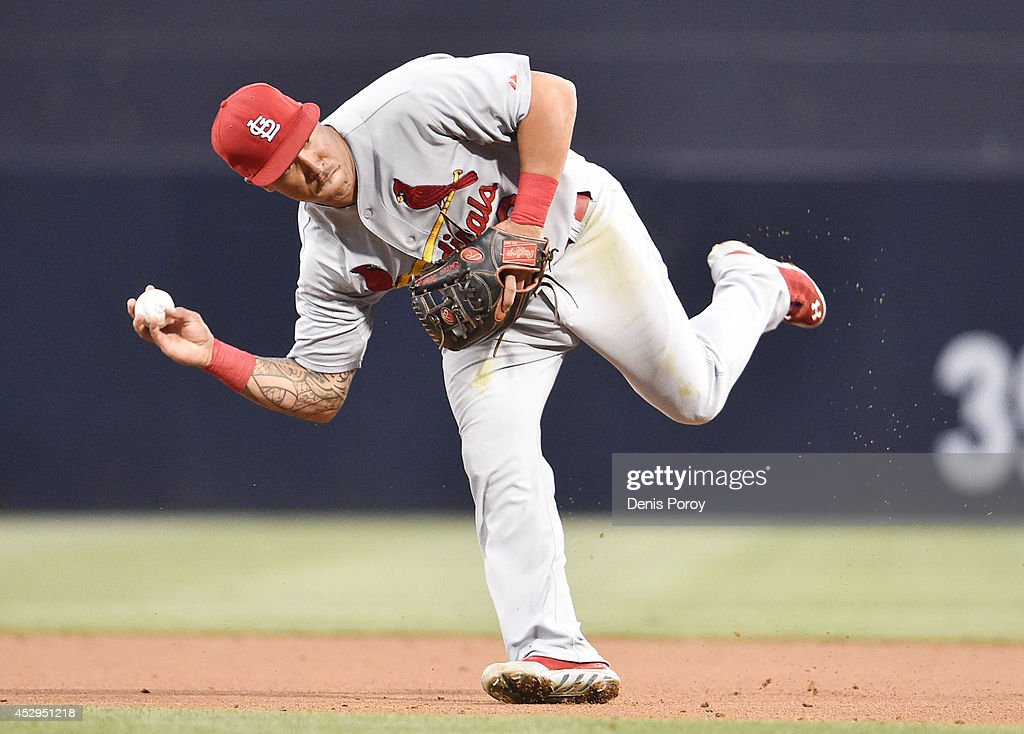 Kolten Wong #16 of the St. Louis Cardinals makes the throw to get the out at first on a ball hit by Yonder Alonso #23 of the San Diego Padres during the second inning of a baseball game at Petco Park July 30, 2014 in San Diego, California.