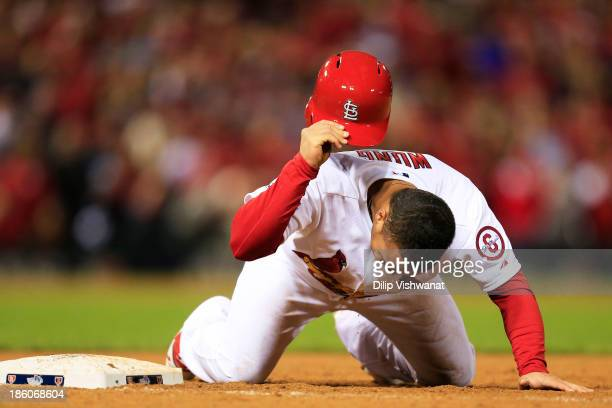 Kolten Wong of the St Louis Cardinals reacts after being picked off at first by Koji Uehara of the Boston Red Sox in the ninth inning to end Game...