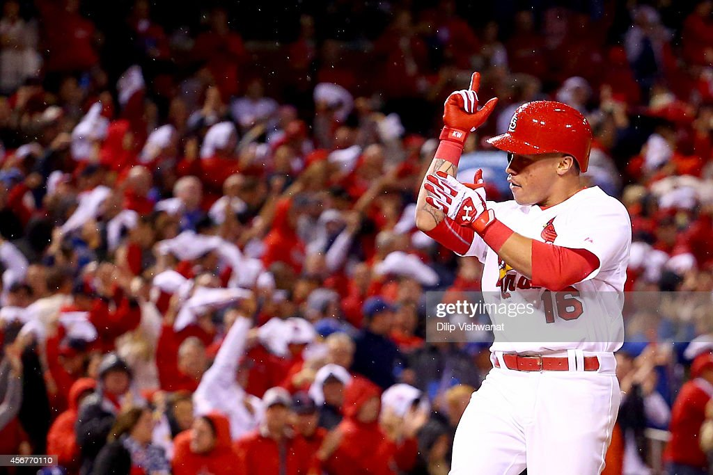 Kolten Wong of the St Louis Cardinals reacts after he hits a tworun home run in the seventh inning against the Los Angeles Dodgers in Game Three of...