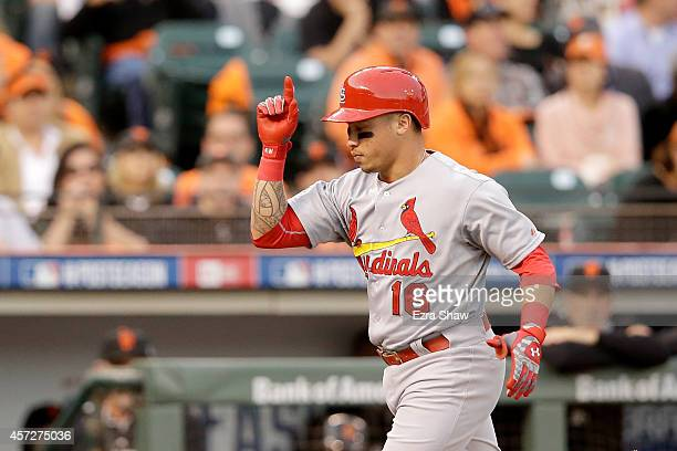 Kolten Wong of the St Louis Cardinals rounds the bases after hitting a solo home run in the third inning against the San Francisco Giants during Game...