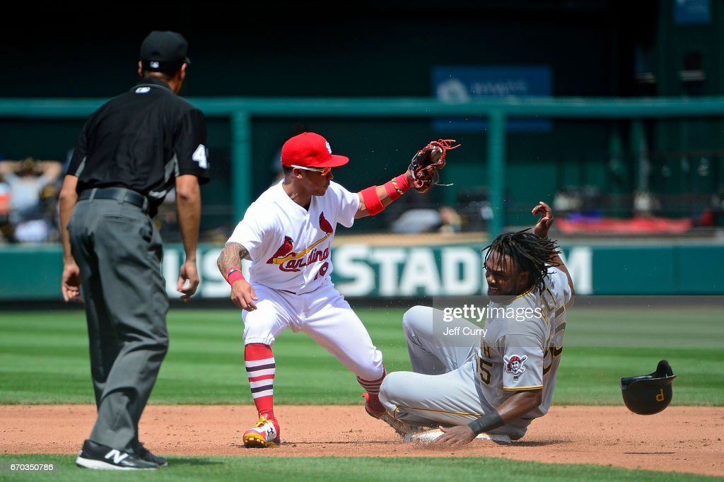 Kolten Wong #16 of the St. Louis Cardinals tags out Josh Bell #55 of the Pittsburgh Pirates during the sixth inning at Busch Stadium on April 19, 2017 in St Louis, Missouri.