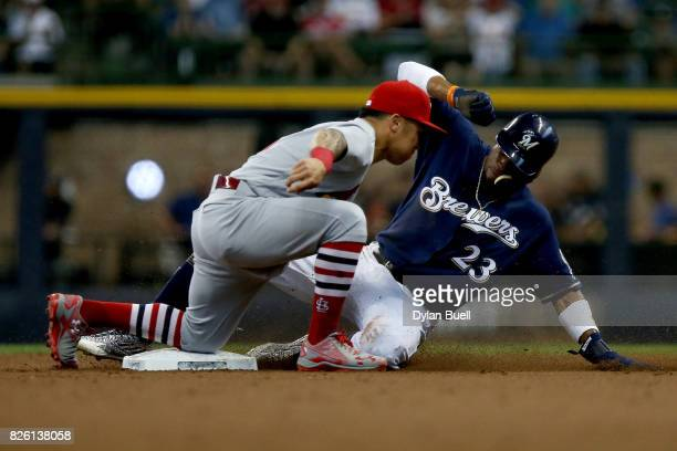 Kolten Wong of the St Louis Cardinals tags out Keon Broxton of the Milwaukee Brewers during a steal attempt in the second inning at Miller Park on...