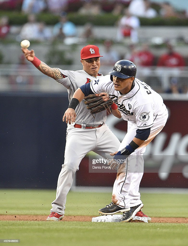 Kolten Wong #16 of the St. Louis Cardinals throws over Everth Cabrera #2 of the San Diego Padres as he tries to turn a double play during the first inning of a baseball game at Petco Park July 30, 2014 in San Diego, California.
