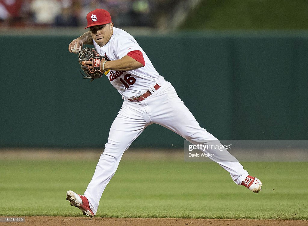 <a gi-track='captionPersonalityLinkClicked' href=/galleries/search?phrase=Kolten+Wong&family=editorial&specificpeople=9003005 ng-click='$event.stopPropagation()'>Kolten Wong</a> #16 of the St. Louis Cardinals throws the ball to first for the out in the sixth inning against the Chicago Cubs at Busch Stadium on April 11, 2014 in St. Louis, Missouri. The Cubs defeated the Cardinals 6-3 in eleven innings.