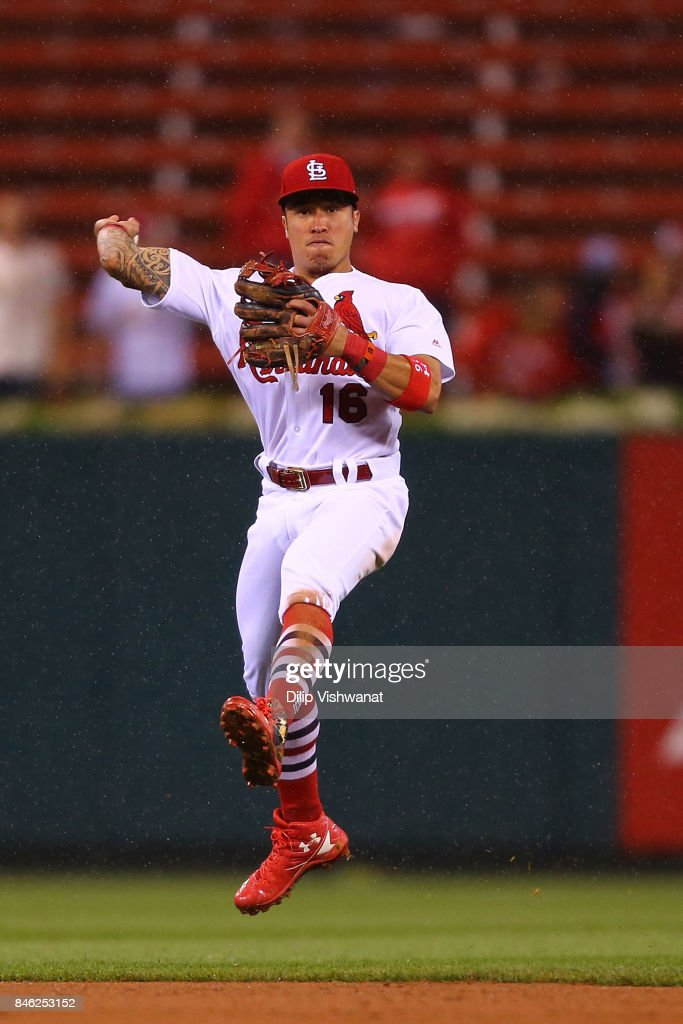 Kolten Wong #16 of the St. Louis Cardinals throws to first base against the Cincinnati Reds in the eighth inning at Busch Stadium on September 12, 2017 in St. Louis, Missouri.