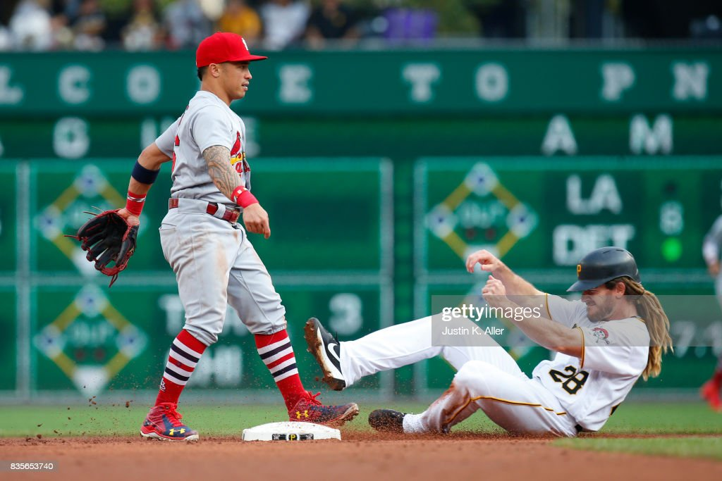 Kolten Wong #16 of the St. Louis Cardinals turns a double play in the second inning against John Jaso #28 of the Pittsburgh Pirates at PNC Park on August 19, 2017 in Pittsburgh, Pennsylvania.