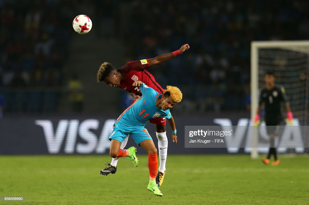 Komal Thatal of India battles with Chris Gloster of United States of America during the FIFA U-17 World Cup India 2017 group A match between India and USA at Jawaharlal Nehru Stadium on October 6, 2017 in New Delhi, India.