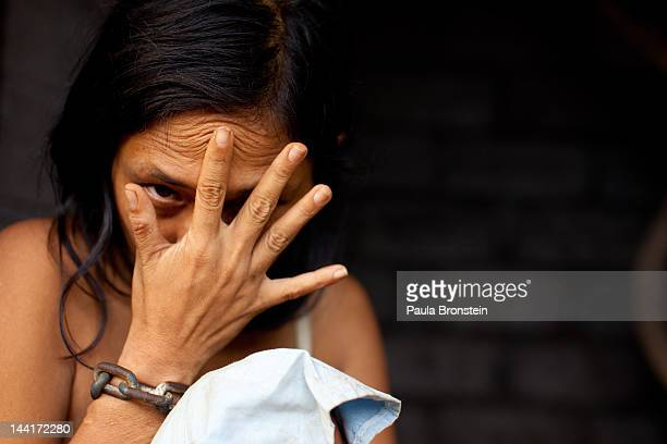 Komang who is diagnosed with Schizophrenia sits in her room where she is chained May 4 2012 in Buleleng Bali Indonesia Komang is shackled by her own...