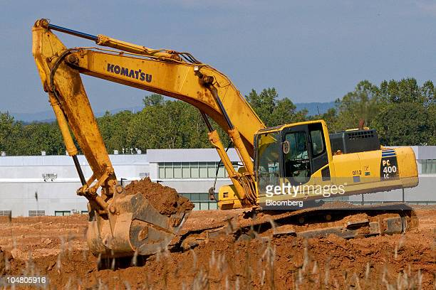 A Komatsu excavator works as construction continues on the grounds of a $1 billion Apple Inc data center site in Maiden North Carolina US on Tuesday...
