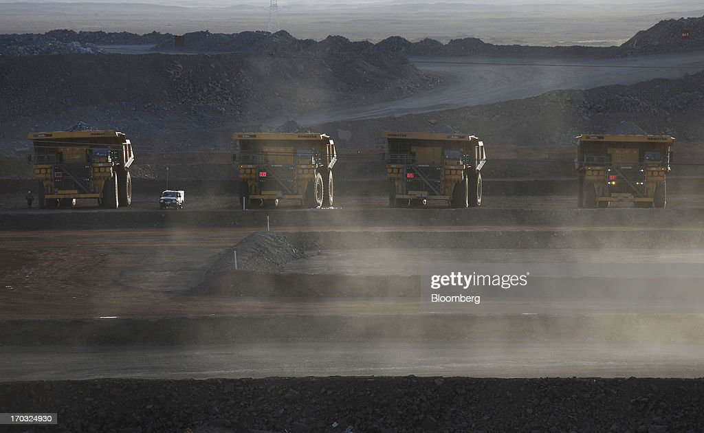 Komatsu Ltd. dump trucks sit at the open pit of the Oyu Tolgoi copper-gold mine, jointly owned by Rio Tinto Group's unit Turquoise Hill Resources Ltd. and Erdenes Oyu Tolgoi LLC, in Khanbogd, the South Gobi desert, Mongolia, on Thursday, June 6, 2013. Rio Tinto, the world's second-biggest mining company, is expected to start first shipments from its $6.6 billion copper-gold mine in Mongolia this month. Tomohiro Ohsumi/Bloomberg via Getty Images