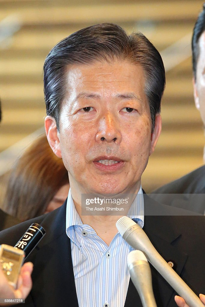 Komeito, junior coalition of ruling Liberal Democratic Party, leader <a gi-track='captionPersonalityLinkClicked' href=/galleries/search?phrase=Natsuo+Yamaguchi&family=editorial&specificpeople=5718603 ng-click='$event.stopPropagation()'>Natsuo Yamaguchi</a> is surrounded by media reporters after his meeting with Prime Minister Shinzo Abe at Abe's official residence on May 30, 2016 in Tokyo, Japan. Abe has decided to postpone the scheduled increase in the consumption tax rate, from 8 to 10 percent, citing sluggish global economic conditions and the powerful earthquakes that struck Kyushu. Abe will not dissolve the Lower House for a snap election for voters' opinion on his decision.