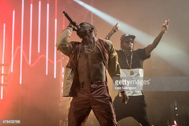 Konan and Krept of Krept and Konaon perform onstage during day 1 of New Look Wireless Festival 2015 at Finsbury Park on July 3 2015 in London England