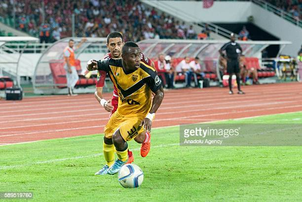 Konan Ruffin Ngouan of ASEC and Reda El Hajhouj of Wydad Casablanca vie for the ball during the Group A match of CAF Champions League between Wydad...
