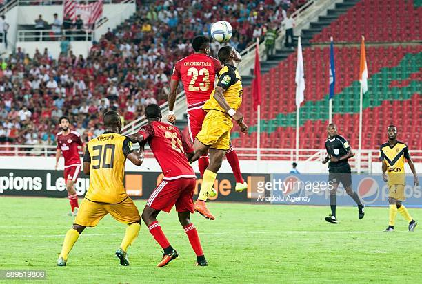 Konan Ruffin Ngouan of ASEC in action against Fabrice Ondama and Chisom Chikatara of Wydad Casablanca during the Group A match of CAF Champions...