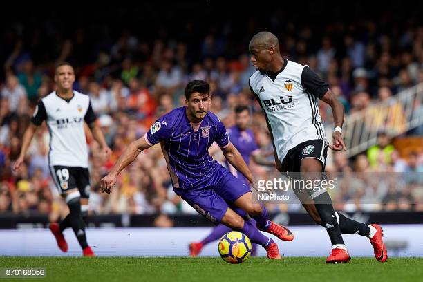 Kondogbia of Valencia CF competes for the ball with Gabriel of CD Leganes during the La Liga match between Valencia CF and CD Leganes at Mestalla...